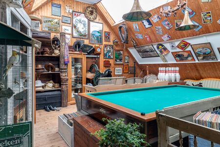 Weerselo, The Netherlands - August 16, 2019: Exposition of vintage furniture and billiards table at Dutch flea market
