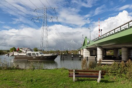 Steel bridge over river Vecht near Amsterdam with passing yacht Stock Photo