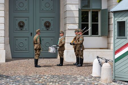 Budapest, Hungary - Juli 13, 2019: Changing the military guard in front of the Hungarian Presidential Sandor Palace