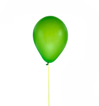 Green helium balloon for birthday and celebrations isolated on white background Stock Photo