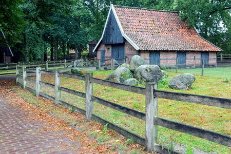 Ootmarsum, The Netherlands - August 18, 2019: Dutch rural open-air museum with old shed Editorial