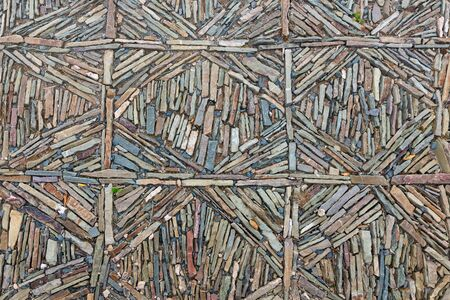 Symmetrical pavement background of colorful slate stones 版權商用圖片