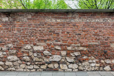 Background of old brick wall with small and big stones
