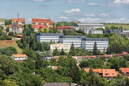 Aerial view Eger, Hungarian Country town with flats build against a hill