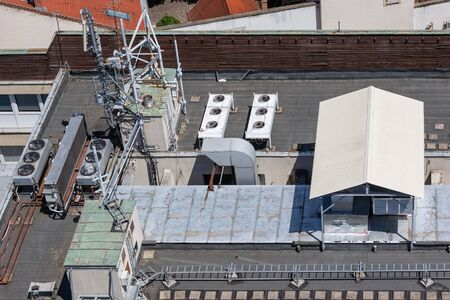 Aerial view roof apartment building with communication equipment and air conditioning machinery