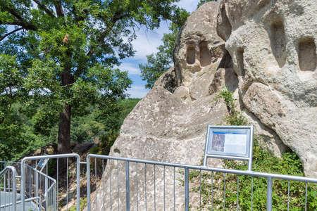 Szomolya , Hungary - July 07, 2019: Pathway with information panel along Beehive stones or beehive rocks near Szomolya, Hungary Redactioneel