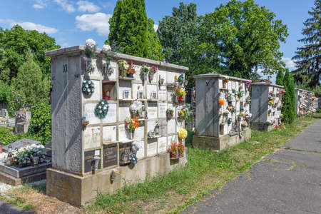 Eger , Hungary - July 08, 2019: Columbarium with flowers in an Hungarian cemetery Redactioneel