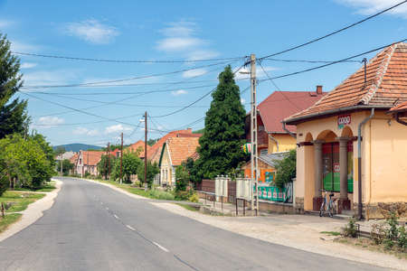 Szomolya , Hungary - July 07, 2019: Main street Hungarian rural village Szomolya with tiny supermarket Redactioneel