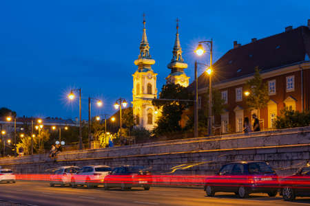 Budapest, Hungary - July 14, 2019: Night view at Church of St. Anne with traffic light trails in Budapest, Hungary