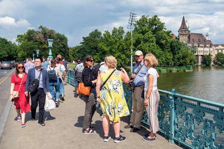 Budapest, Hungary - July 14, 2019: People at Millennium bridge near Vajdahunyad Castle in Budapest, hungary Redactioneel