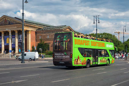 Budapest, Hungary - July 14, 2019: Heroes square with sightseeing bus near Hall of Art in Budapest, Hungary