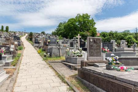 Szomolya , Hungary - July 07, 2019: Graveyard with footpath upon a hill in Szomolya near Eger, Hungary Redactioneel