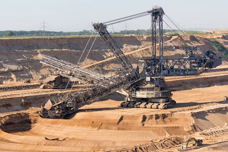 Brown coal open pit landscape with enormous digging excavator in Garzweiler mine Germany Stockfoto