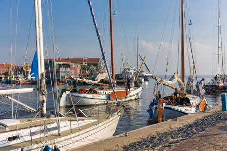 Urk, The Netherlands- October 11, 2008: Historic sailing ships leaving harbor of Urk, The Netherlands