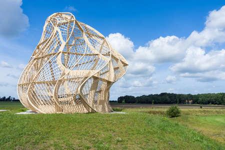 Emmeloord, The Netherlands- June 17, 2011: Sculpture The Beacon near former trash pile of Emmeloord 新闻类图片