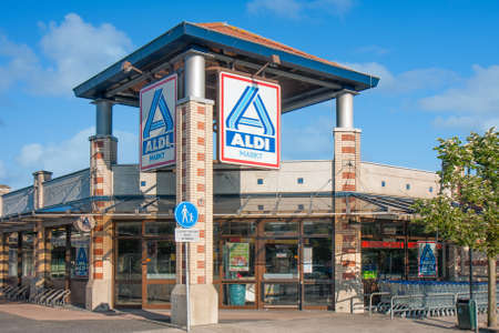 Urk, The Netherlands- July 04, 2011: Entrance Dutch shopping mall with big Billboard of ALDI drugstore