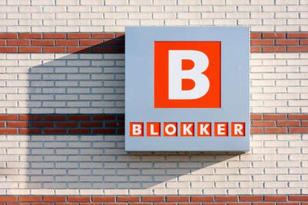 Urk, The Netherlands- July 04, 2011: Brick wall with billboard of Dutch shop chain Blokker 新闻类图片