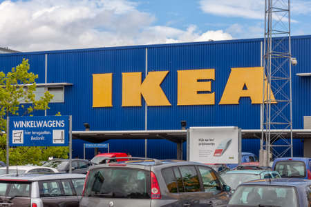 Amsterdam, The Netherlands- July 07, 2011: Facade IKEA Store with car parking in front 新闻类图片
