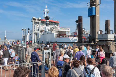 Hollum, The Netherlands- August 02, 2011: Passengers waiting for Ferry from Holwerd to Dutch island Ameland