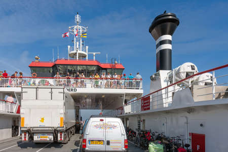 Hollum, The Netherlands- August 02, 2011: Passengers at deck Ferry from Holwerd to Dutch island Ameland