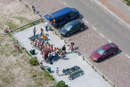 Ameland, The Netherlands- August 02, 2011: Aerial view at a car park with picnicking people
