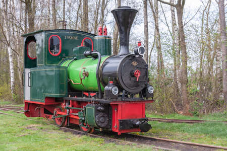Barger Compascuum, The Netherlands- April 14, 2012: Historic steam locomotive used for digging peat at Dutch moorland 新闻类图片