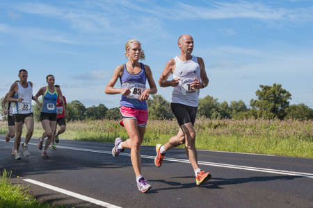 Urk, The Netherlands- September 08, 2012: Runners of foot race Fish Potato Run between Urk and Emmeloord, The Netherlands 新闻类图片