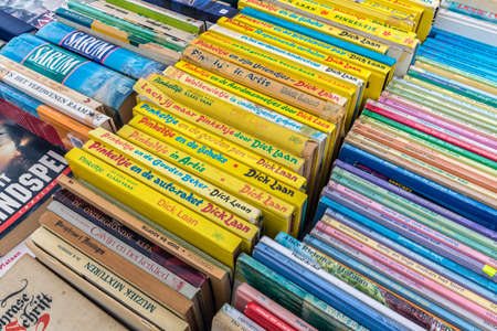 Urk, The Netherlands- April 30, 2013: Dutch flea market with juvenile books of Pinkeltje 新闻类图片