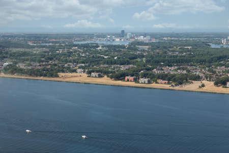 Aerial view Dutch city Almere with residential area between lake Markermeerand lake Gooimeer