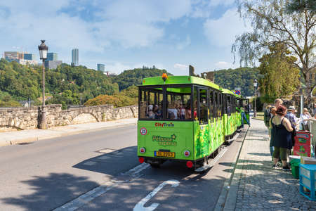 Luxembourg City, Luxembourg - August 18, 2018: People buying tickets for drive with citytrain through Luxemburg city