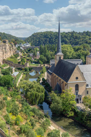 Luxembourg city, the capital of Grand Duchy of Luxembourg, aerial view at old medieval casemates and grund with Neumunster Aabbey 免版税图像