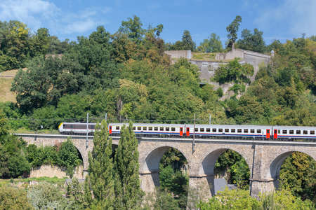 Luxembourg city with old historic bridge near Kirchberg and passing express train