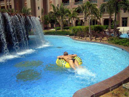 The girl swim on yellow circle Stock Photo - 3053314