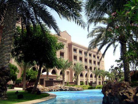 bilding: Emirates Palace Hotel and pool. Stock Photo