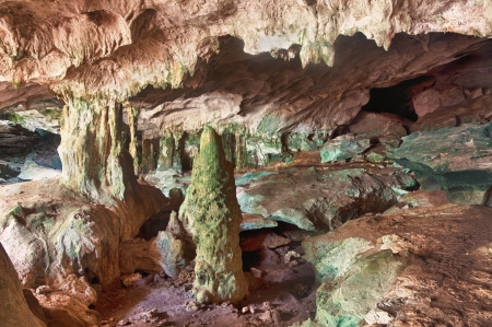 dank: Interior of the limestone caves known as the Conch Bar Caves on the island of Middle Caicos in the Turks and Caicos Islands. Stock Photo