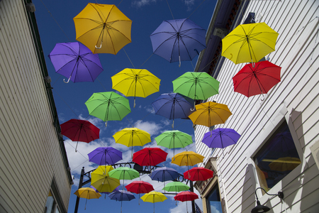 hampshire: Display of colorful umbrellas on Main Street, Littleton, New Hampshire Stock Photo