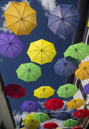 littleton: Colorful umbrellas on Main Street in Littleton, New Hampshire Stock Photo