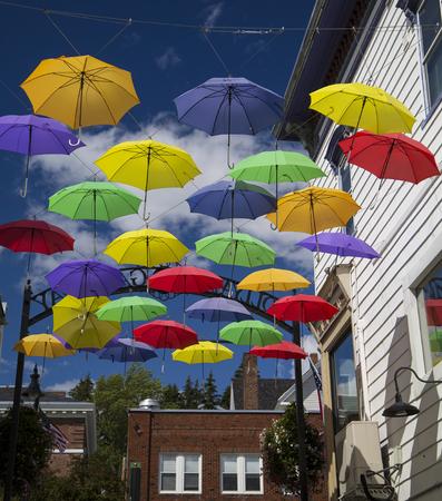 main street: Display of colorful umbrellas on Main Street, Littleton, New Hampshire Archivio Fotografico
