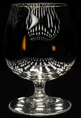 BARWARE: Small brandy snifter (three inches high) with light reflections