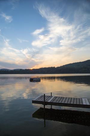 Dock and swim platform at Squam Lake, New Hampshire, at sunset