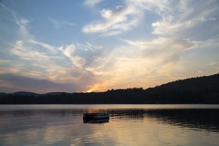 Metal swim platform, Squam Lake, New Hampshire, at sunset Stockfoto
