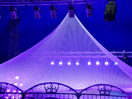 Blue tent in a circus with lights.