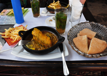 Roasted chicken, fries, bread and mint tea in Chefchaouen medina.