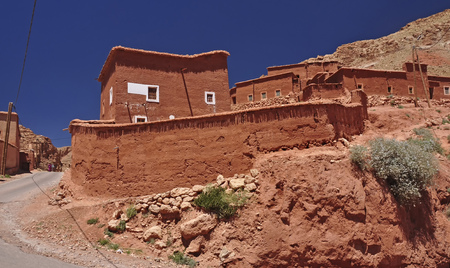 Brown houses made of clay in a mountain village in the High Atlas. Morocco, Africa.