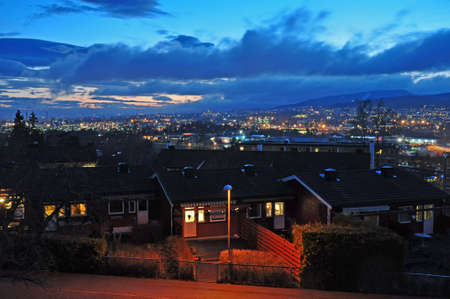 Evening view of Oslo with old historic houses in the foreground and mountains on the horizon. Norway.Europe. Redakční