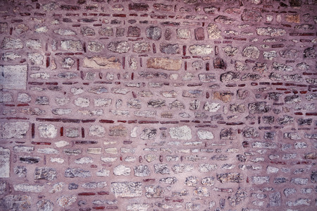 stone wall with purple tint for texture, background, text or image