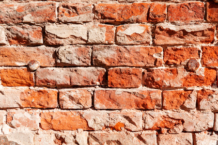 brick wall with metal nails on the edges of the image Stock Photo