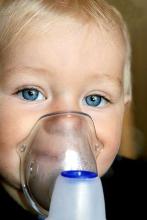 sickly: Little, blond-hair, asthmatic boy taking inhalation therapy