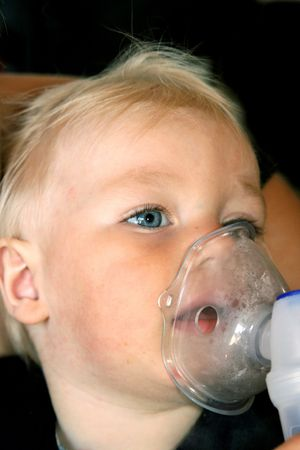 inhalation: Little, blond-hair, asthmatic boy taking inhalation therapy