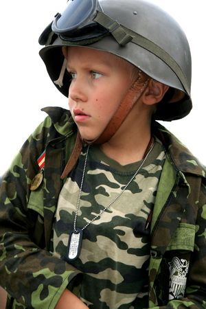 to obey: Boy in a  soldiers uniform with serious expression